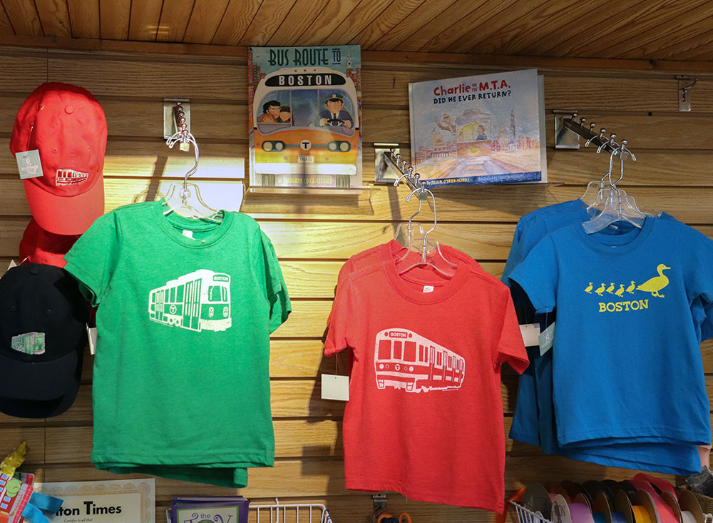 ss-18_Boston-Trolley-T-shirts-on-Wall-with-books